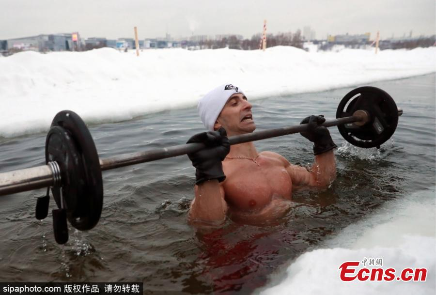 Bodybuilding and fitness trainer Andrei Lobkov sets a new world record for the most consecutive bench presses in 1 minute while standing in an ice hole, in the frozen Moskva River in north-west Moscow; the barbell is half the weight of Lobkov; Lobkov dedicated his record attempt to John the Baptist. (Photo/Sipaphoto.com)