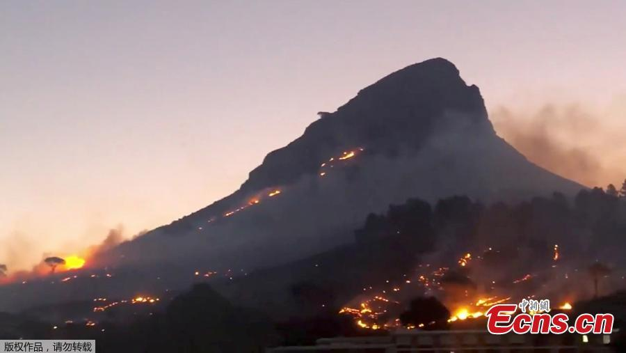 Smoke rises from a burning mountainside in Cape Town, South Africa, January 27, 2019, in this picture obtained from social media. (Photo/Agencies)