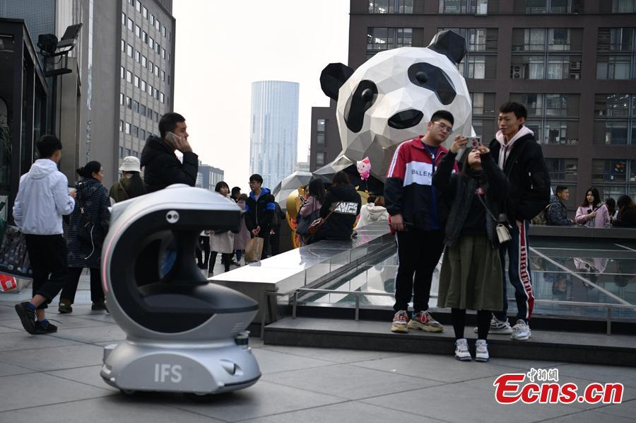 One of three robots patrols at the International Finance Square, a mega integrated complex comprising of high-end malls, office towers and serviced apartments, in Chengdu, Southwest China's Sichuan Province, Jan. 28, 2019. (Photo: China News Service/Liu Zhongjun)