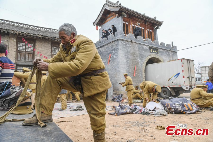 Li Tieliang, 69, and other farmers work as extras in a TV drama being shot in Beishanyun Village in Yushe County, North China's Shanxi Province, Jan. 24, 2019. The village has more than 30 well-preserved buildings from the Ming and Qing dynasties, making it a good location to shoot historical film and TV dramas. In recent years, many locals have migrated to other places, while some remaining farmers have found work as extras. Li and his wife survive by farming, while their children work in other cities. Li now works part-time as an extra and earns about 100 yuan ($14) a day. (Photo: China News Service/Wu Junjie)