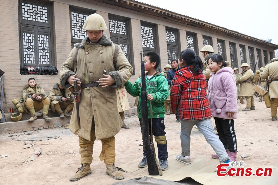 Li Tieliang\'s son works as extra in a TV drama being shot in Beishanyun Village in Yushe County, North China's Shanxi Province, Jan. 24, 2019. The village has more than 30 well-preserved buildings from the Ming and Qing dynasties, making it a good location to shoot historical film and TV dramas. In recent years, many locals have migrated to other places, while some remaining farmers have found work as extras. Li and his wife survive by farming, while their children work in other cities. Li now works part-time as an extra and earns about 100 yuan ($14) a day. (Photo: China News Service/Wu Junjie)