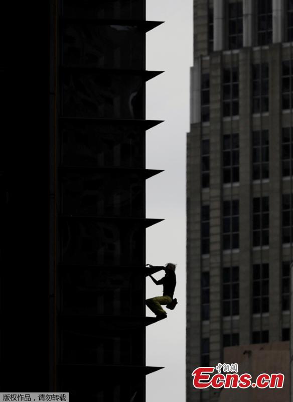 French urban climber Alain Robert stages his first climb in the Philippines as he scales a 43-floor skyscraper in Makati City, Manila, the Philippines, Jan. 29, 2019. (Photo/Agencies)