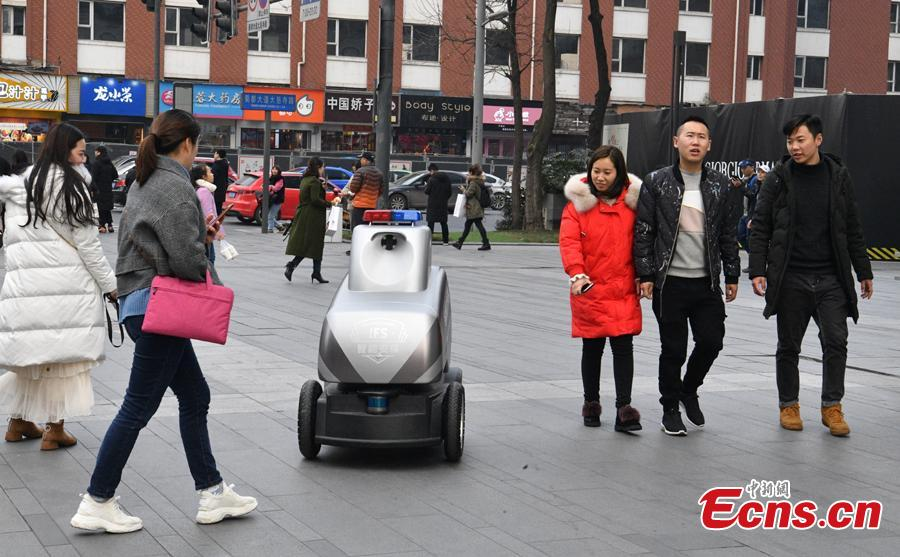 One of three robots during a safety patrol at the International Finance Square, a mega integrated complex comprising of high-end malls, office towers and serviced apartments, in Chengdu, Southwest China's Sichuan Province, Jan. 28, 2019. (Photo: China News Service/Liu Zhongjun)
