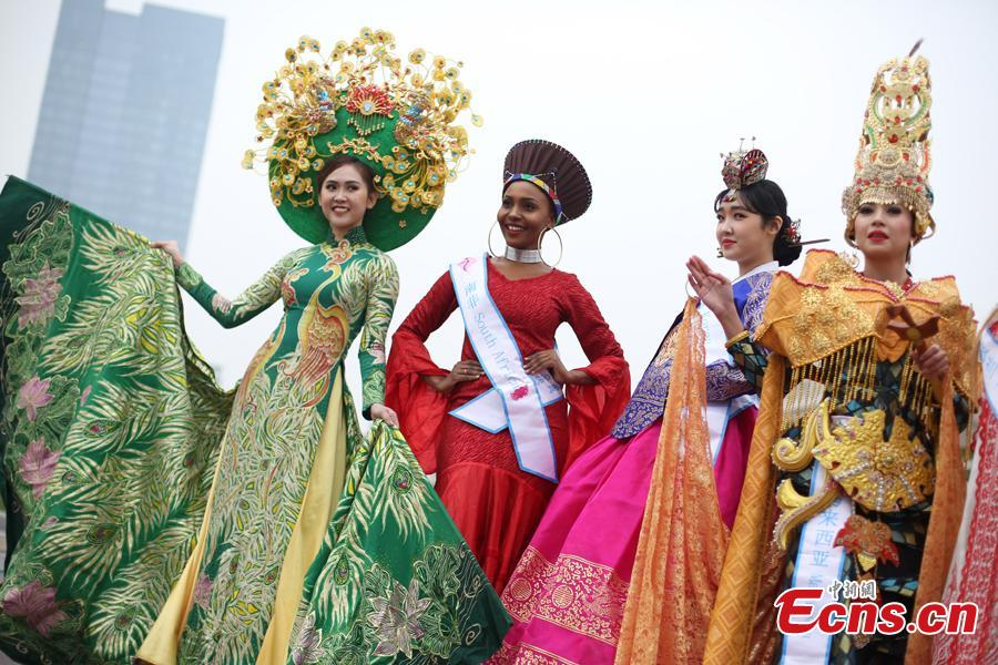 Contestants of Miss All Nations Pageant pose for photo in Nanjing, east China\'s Jiangsu Province, Jan. 29, 2019. The annual event is held to promote Eco-Tourism. Beauties from 42 countries and regions will compete at the annual pageant. (Photo: China News Service/Yang Bo)