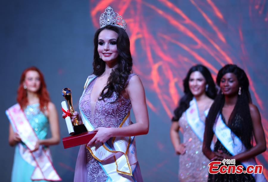 The contestant from Russia poses after winning first place in the world final of the 53rd Miss All Nations in Nanjing City, Jiangsu Province, Jan. 29, 2019. The pageant with the theme of eco-tourism included components of evening dress, bikini and national costumes. Participants from Russia, Mexico and Vietnam won the top three places. (Photo: China News Service/Yang Bo)