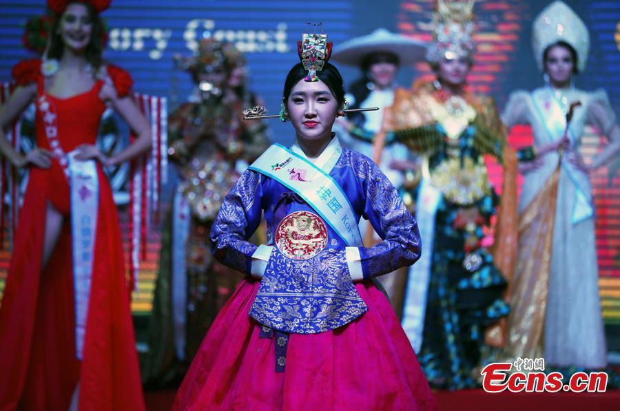 A participant competes in the world final of the 53rd Miss All Nations in Nanjing City, Jiangsu Province, Jan. 29, 2019. The pageant with the theme of eco-tourism included components of evening dress, bikini and national costumes. Participants from Russia, Mexico and Vietnam won the top three places. (Photo: China News Service/Yang Bo)