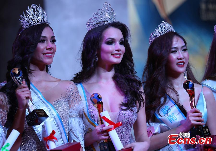 Contestants from Russia (C), Mexico (L) and Vietnam win the top three places in the world final of the 53rd Miss All Nations in Nanjing City, Jiangsu Province, Jan. 29, 2019. The pageant with the theme of eco-tourism included components of evening dress, bikini and national costumes. (Photo: China News Service/Yang Bo)