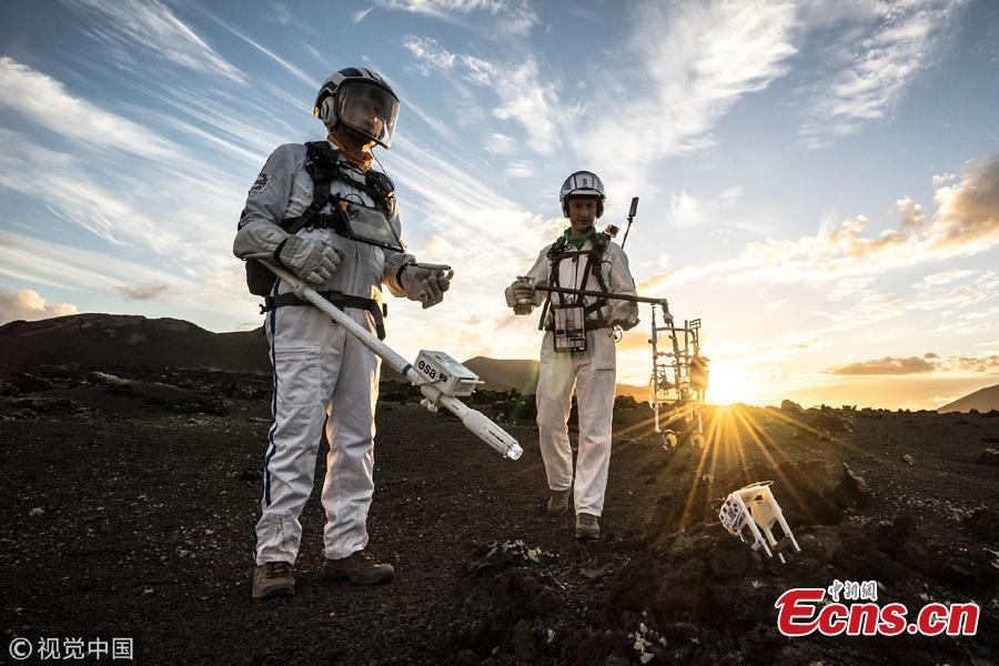 The Pangaea-X crew explore the barren and dry landscape of Lanzarote in the Canary Islands, Spain. Pangaea-X of the European Space Agency (ESA) is a test campaign that brings together geology, high-tech survey equipment and space exploration. Astronauts, scientists, operations experts and instrumentation engineers work side-by-side to advance European know-how of integrated human and robotics mission operations. (Photo/Agencies)