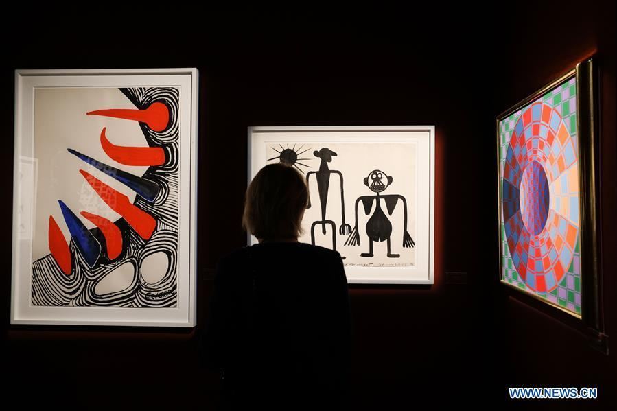 A visitor views the exhibits from Omer Tiroche gallery during the 64th edition of Brafa Art Fair at the Tour & Taxis in Brussels, Belgium, Jan. 28, 2019. A total of 133 Belgian and international galleries presented tens of thousands of art pieces at the fair, which will last till Feb. 3, 2019. Created in 1956, the Brafa Art Fair is one of the world\'s oldest and most prestigious art fairs. (Xinhua/Zheng Huansong)