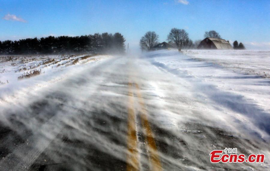 Drifting snow obscures a road near Mount Joy in Lancaster County, Pa., Jan. 30, 2019. A bitter deep freeze is moving into the Northeast from the Midwest, sending temperatures plummeting and making road conditions dangerous. (Photo/Agencies)