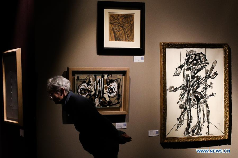 A visitor views exhibits from Simon Studer Art during the 64th edition of Brafa Art Fair at the Tour & Taxis in Brussels, Belgium, Jan. 28, 2019. A total of 133 Belgian and international galleries presented tens of thousands of art pieces at the fair, which will last till Feb. 3, 2019. Created in 1956, the Brafa Art Fair is one of the world\'s oldest and most prestigious art fairs. (Xinhua/Zheng Huansong)