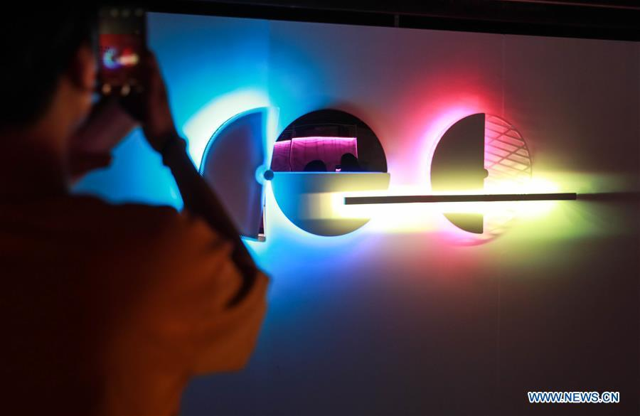 A visitor views a light installation during the Bangkok Design Week 2019 in Bangkok, Thailand, Jan. 30, 2019. The Bangkok Design Week 2019 was held under the theme \