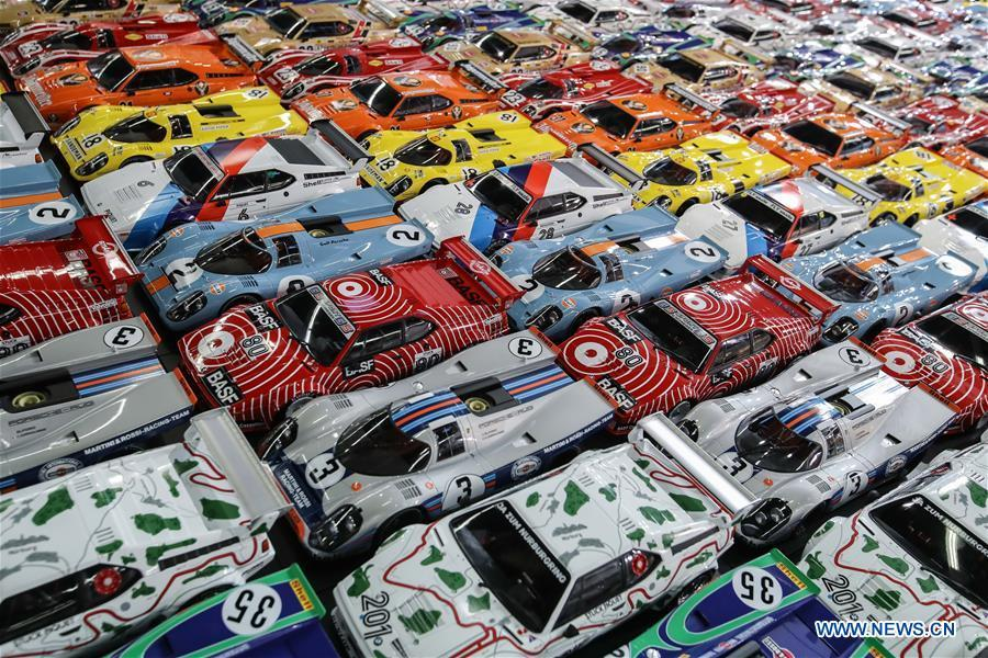 Model vehicles are displayed at the booth of Minichamps in the Spielwarenmesse exhibition in Nuremberg, Germany, Jan. 30, 2019. Spielwarenmesse, a leading international fair for toys, hobbies and leisure, kicked off in Nuremberg on Wednesday. Around 2,900 manufacturers from all over the world gathered at the annual trade fair, which will last until Feb. 3 and is expected to attract 71,000 visitors from over 125 nations and regions. (Xinhua/Shan Yuqi)
