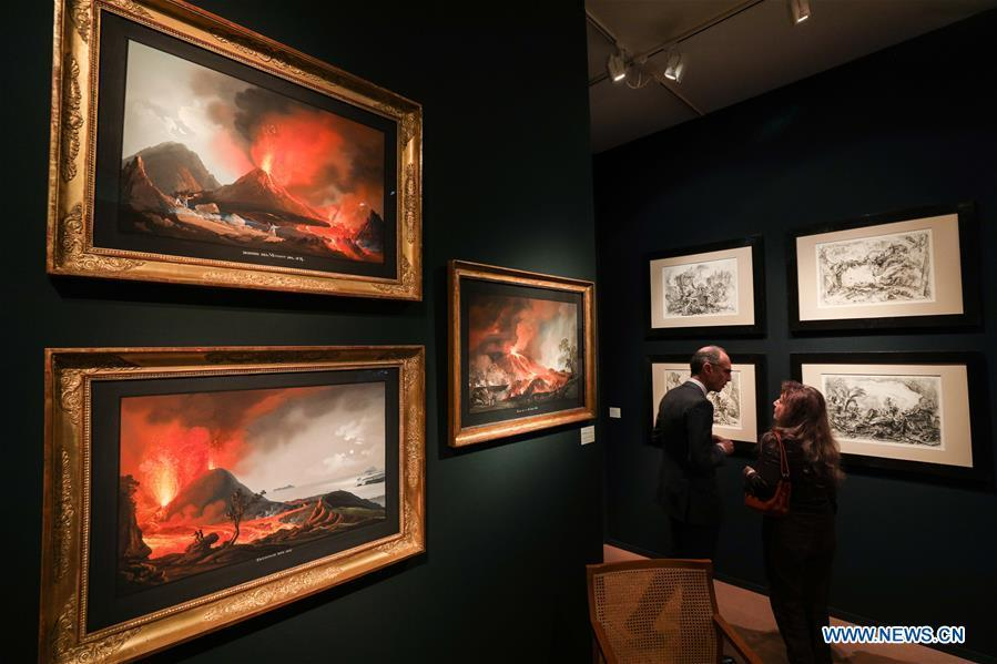 People talk at the stand of Grand-Rue Marie-Laure Rondeau Gallery during the 64th edition of Brafa Art Fair at the Tour & Taxis in Brussels, Belgium, Jan. 28, 2019. A total of 133 Belgian and international galleries presented tens of thousands of art pieces at the fair, which will last till Feb. 3, 2019. Created in 1956, the Brafa Art Fair is one of the world\'s oldest and most prestigious art fairs. (Xinhua/Zheng Huansong)