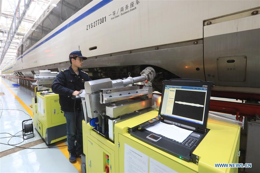 Zhang Yuqi conducts a ultrasound check on a bullet train at a maintenance center in Guiyang, capital of southwest China\'s Guizhou Province, Jan. 30, 2019. As a model train hobbyist, 27-year-old Zhang Yuqi has made and collected more than a hundred model trains. Zhang is also a bullet train mechanic responsible for checking bullet trains during the Spring Festival travel rush at a maintenance center in Guiyang of Guizhou Province. Despite heavy work load and work pressure, Zhang said he is dedicated to ensuring the safety of bullet trains. (Xinhua/Ou Dongqu)