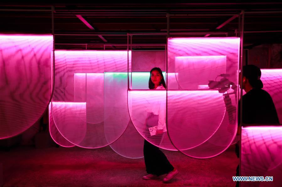 Visitors shoot amid a light installation during the Bangkok Design Week 2019 in Bangkok, Thailand, Jan. 30, 2019. The Bangkok Design Week 2019 was held under the theme \