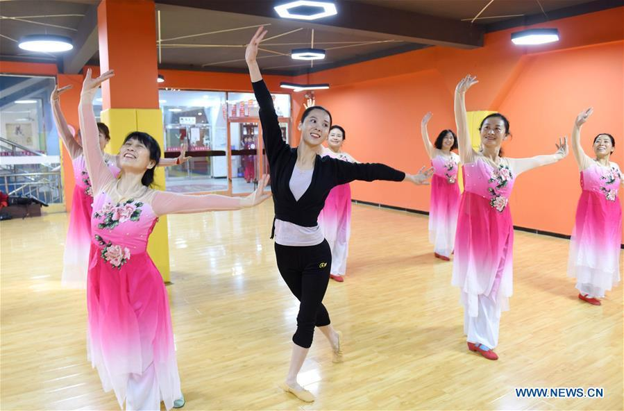 A dance instructor (C) and trainees rehearse dance at a cultural center in Nanhe County, north China\'s Hebei Province, Jan. 30, 2019. More than 2000 people have participated in art training programs at a cultural center in Nanhe County as a way to enrich their life. (Xinhua/Zhu Xudong)