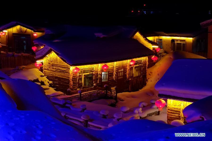 Photo taken by mobile phone shows the night view of Shuangfeng Forest Farm in Mudanjiang City, northeast China\'s Heilongjiang Province, Jan. 30, 2019. The Shuangfeng Forest Farm witnesses frequent snowfalls and is covered with snow for most of the year. The beautiful snow scenery here attracts many visitors from at home and abroad every year. (Xinhua/Yang Siqi)