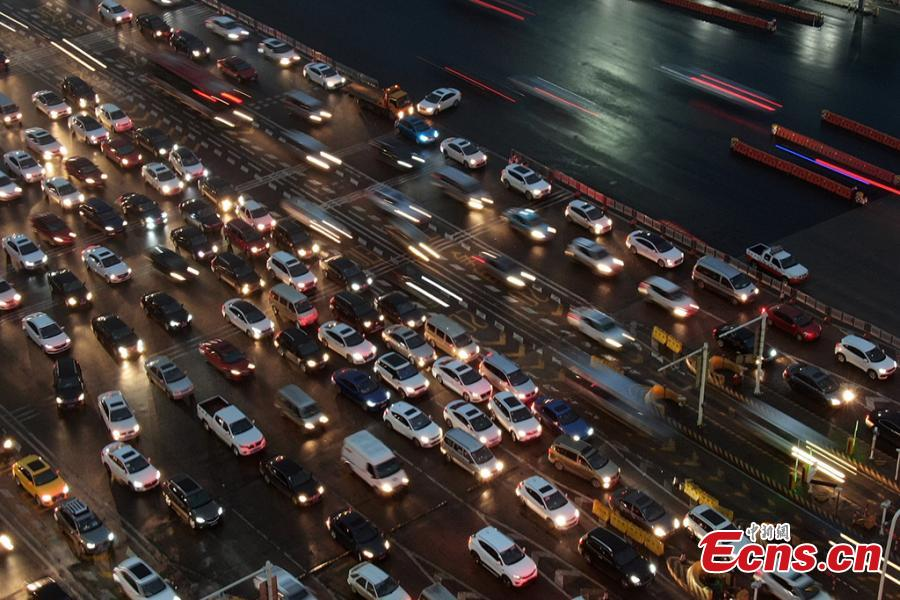 A drone photo shows heavy traffic on an expressway in Nanjing City, East China's Jiangsu Province, Jan. 30, 2019. China is in the midst of its Spring Festival travel rush as millions of people go home for family reunions for the most important festival of the year. (Photo: China News Service/Yang Bo)