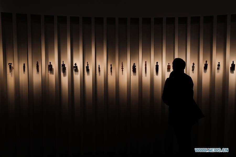 A visitor views the combs from Africa of Didier Claes Gallery during the 64th edition of Brafa Art Fair at the Tour & Taxis in Brussels, Belgium, Jan. 28, 2019. A total of 133 Belgian and international galleries presented tens of thousands of art pieces at the fair, which will last till Feb. 3, 2019. Created in 1956, the Brafa Art Fair is one of the world\'s oldest and most prestigious art fairs. (Xinhua/Zheng Huansong)