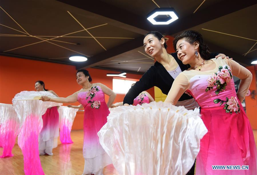 A dance instructor (2nd R) and trainees practice dancing at a cultural center in Nanhe County, north China\'s Hebei Province, Jan. 30, 2019. More than 2000 people have participated in art training programs at a cultural center in Nanhe County as a way to enrich their life. (Xinhua/Zhu Xudong)