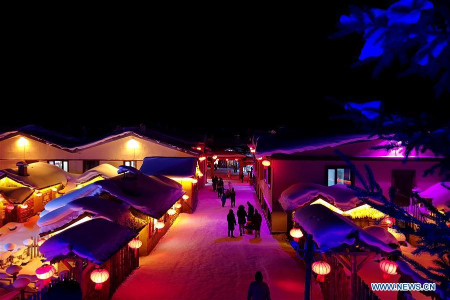 Photo taken with a mobile phone shows the night view of Shuangfeng Forest Farm in Mudanjiang City, northeast China\'s Heilongjiang Province, Jan. 30, 2019. The Shuangfeng Forest Farm witnesses frequent snowfalls and is covered with snow for most of the year. The beautiful snow scenery here attracts many visitors from at home and abroad every year. (Xinhua/Yang Siqi)