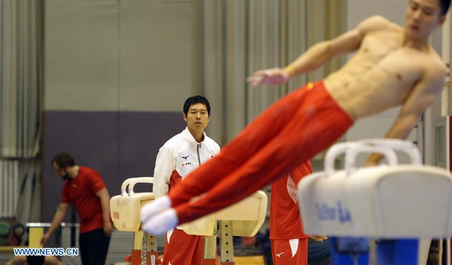 Mizutori Hisashi (C), head coach of Japanese men\'s gymnastics team, watches the training in Beijing, capital of China, Jan. 30, 2019. First-ever China-Japan gymnastics co-training camp started here on Jan. 27. (Xinhua/Luo Yuan)