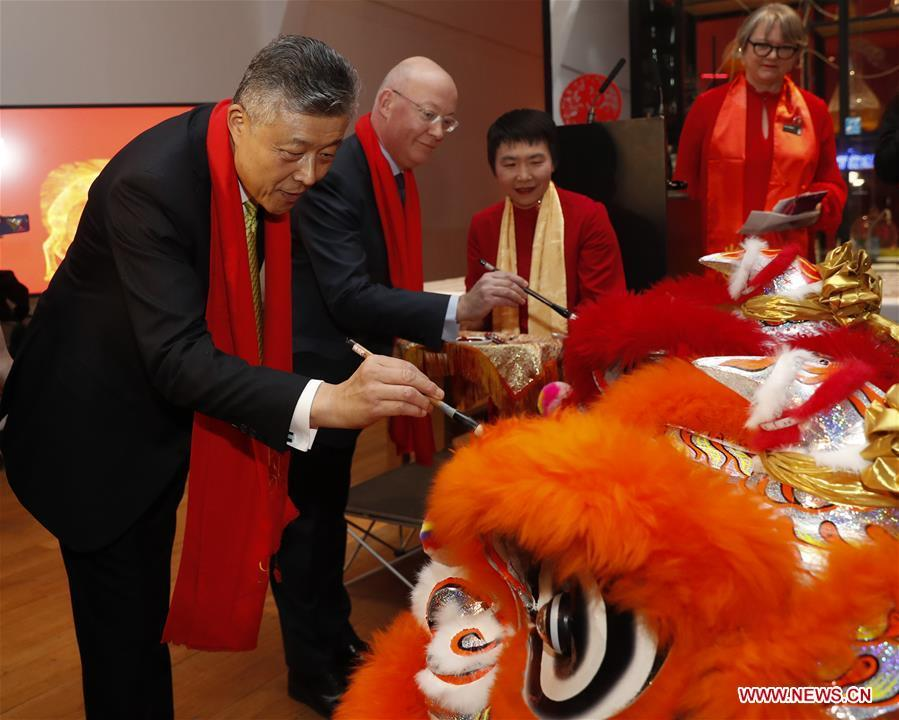 Chinese Ambassador to Britain Liu Xiaoming (1st, L) and Ian Blatchford (2nd L), director of the Science Museum Group, take part in celebrations of the Chinese Lunar New Year at the Science Museum in London, Britain on Jan. 30, 2019. With Chinese folk music, Kongfu performance, and lion and dragon dances, the Science Museum in London was brimming with pleasure Wednesday night. Around 5,000 visitors joined the China Lates programs in the museum to celebrate the Chinese Lunar New Year, which falls on Feb. 5. (Xinhua/Han Yan)