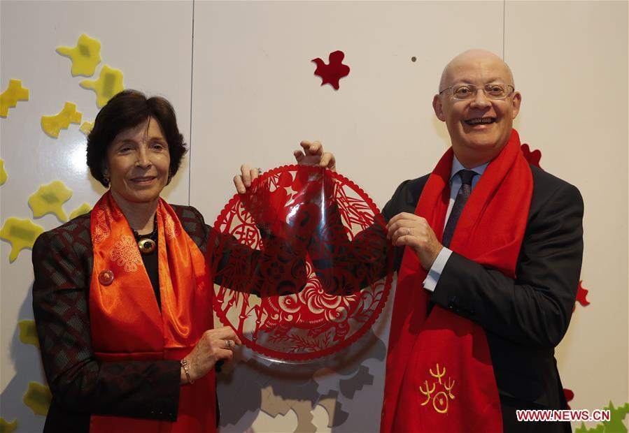 Ian Blatchford (R), director of the Science Museum Group, expresses his good wishes with a Chinese traditional paper-cutting image in his hands ahead of celebrations of the Chinese Lunar New Year at the Science Museum in London, Britain on Jan. 30, 2019. With Chinese folk music, Kongfu performance, and lion and dragon dances, the Science Museum in London was brimming with pleasure Wednesday night. Around 5,000 visitors joined the China Lates programs in the museum to celebrate the Chinese Lunar New Year, which falls on Feb. 5. (Xinhua/Han Yan)