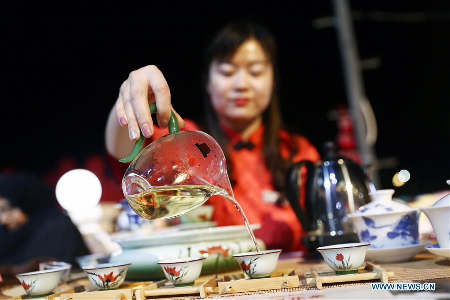 An artist from north China\'s Shanxi Province performs tea art at a temple fair celebrating the Chinese Spring Festival in Sharm el-Sheikh, Egypt, Jan. 30, 2019. The Egyptian tourism city of Sharm el-Sheikh embraced a large festivity where hundreds of rejoiced Egyptians and Chinese celebrated the Chinese Spring Festival together. The event hosted by the Chinese Embassy in Egypt kicked off Wednesday and will run through Friday. (Xinhua/Ahmed Gomaa)