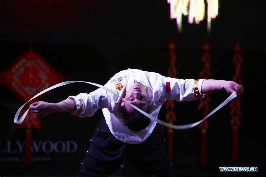 An artist from north China\'s Shanxi Province performs noodle-making skills at a temple fair celebrating the Chinese Spring Festival in Sharm el-Sheikh, Egypt, Jan. 30, 2019. The Egyptian tourism city of Sharm el-Sheikh embraced a large festivity where hundreds of rejoiced Egyptians and Chinese celebrated the Chinese Spring Festival together. The event hosted by the Chinese Embassy in Egypt kicked off Wednesday and will run through Friday. (Xinhua/Ahmed Gomaa)