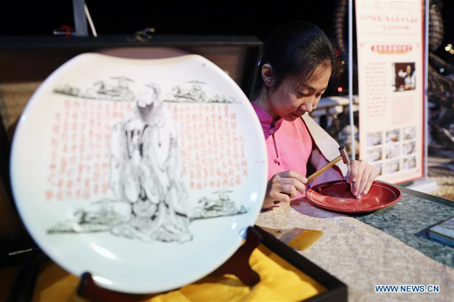 An artist from north China\'s Shanxi Province displays porcelain carving skills at a temple fair celebrating the Chinese Spring Festival in Sharm el-Sheikh, Egypt, Jan. 30, 2019. The Egyptian tourism city of Sharm el-Sheikh embraced a large festivity where hundreds of rejoiced Egyptians and Chinese celebrated the Chinese Spring Festival together. The event hosted by the Chinese Embassy in Egypt kicked off Wednesday and will run through Friday. (Xinhua/Ahmed Gomaa)