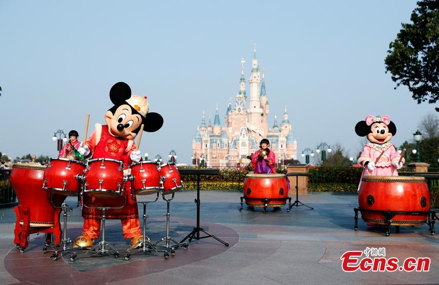 Mickey and Minnie play drums to greet the upcoming \