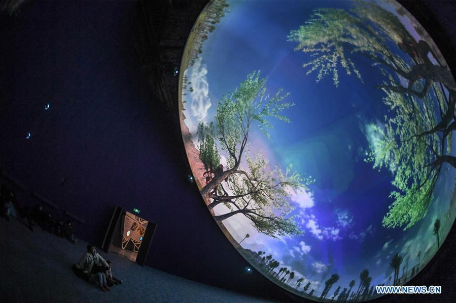 Visitors watch a 3D film at the Anji Branch of Zhejiang Museum of Natural History in Anji County, east China\'s Zhejiang Province, Jan. 31, 2019. The museum attracts lots of visitors during the winter vacation. (Xinhua/Xu Yu)