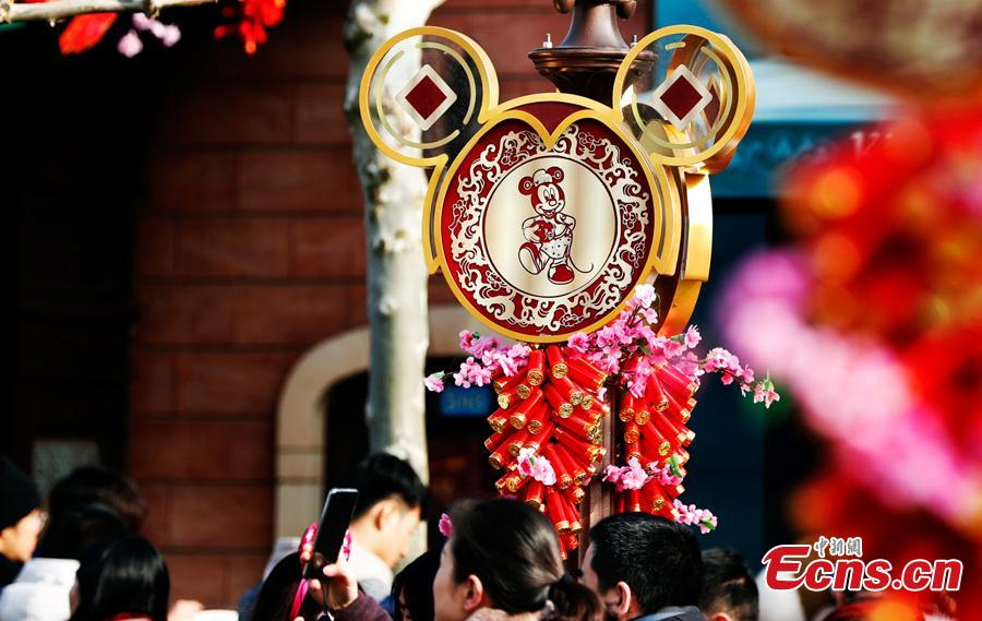 Visitors are seen in the Shanghai Disney Resort to greet \