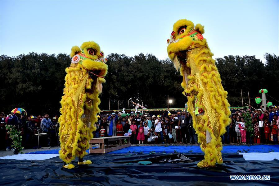 People view a lion dance performance during a two-day kite festival kicked off in Cox\'s Bazar in southeastern Bangladesh on Feb. 1, 2019. (Xinhua/Stringer)