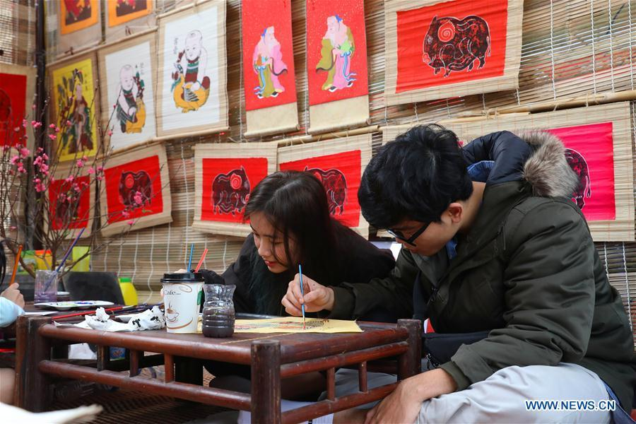 People work on traditional color paintings for the upcoming Lunar New Year in Hanoi, capital of Vietnam, Feb. 1, 2019. The Lunar New Year festival, also called Tet in Vietnamese, is one of the long-standing traditions of Vietnamese people. (Xinhua/Wang Di)