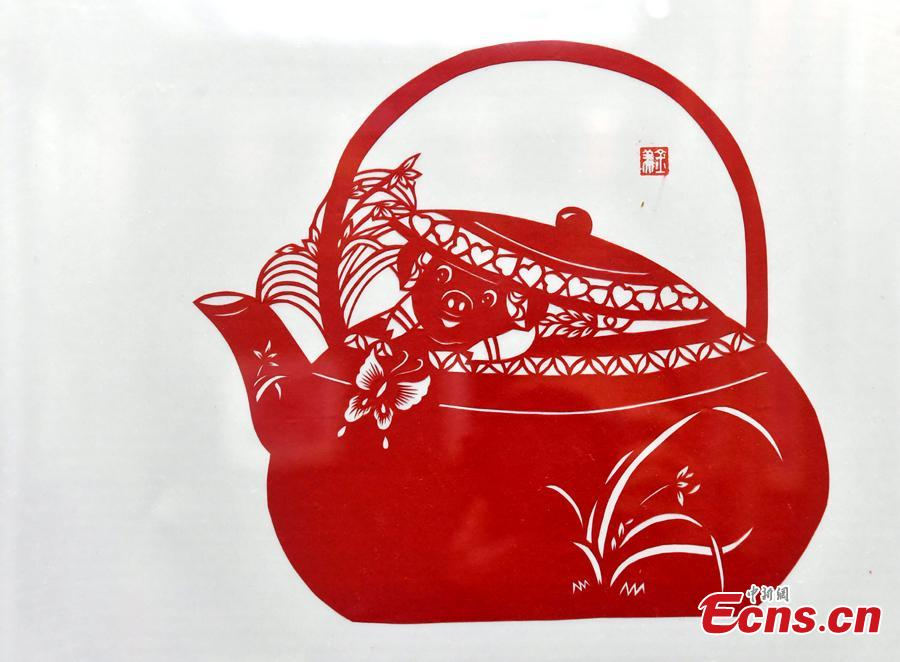 A pig-themed paper-cutting artwork is on display to  celebrate the upcoming Chinese New Year in Fuzhou, Fujian Province, Feb. 1, 2019. The Chinese New Year, or Spring Festival, falls on Feb. 5 this year. The Chinese paper-cutting has a history of more than 1,500 years. It was listed in the UNESCO Intangible Cultural Heritage Lists in 2009. (Photo/China News Service/Lyv Ming)
