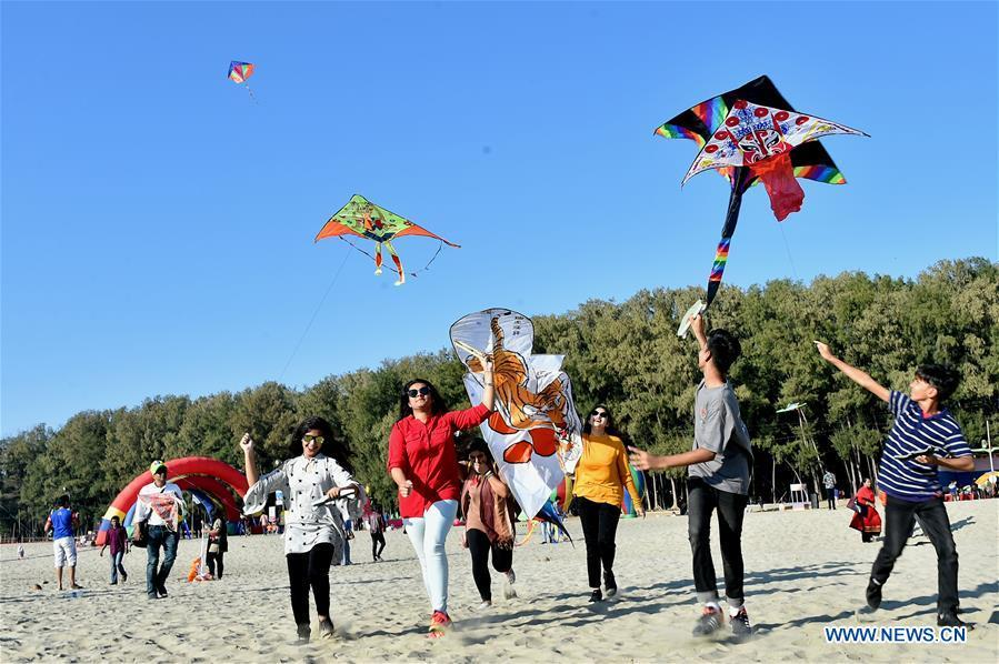 People fly kites during a two-day kite festival kicked off in Cox\'s Bazar in southeastern Bangladesh on Feb. 1, 2019. (Xinhua/Stringer)