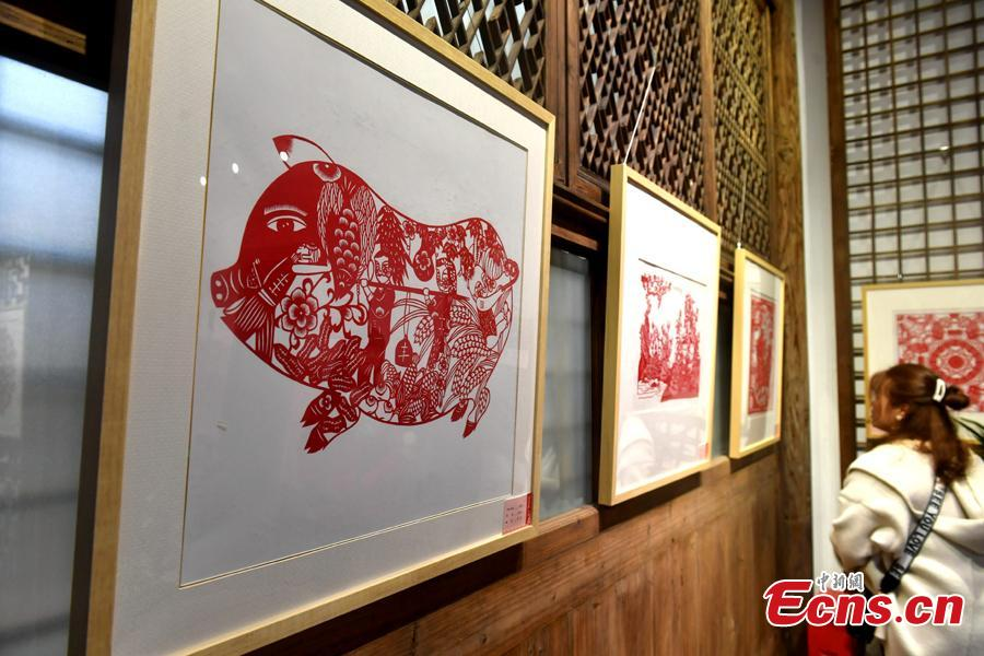 Pig-themed paper-cutting artworks are on display to  celebrate the upcoming Chinese New Year in Fuzhou, Fujian Province, Feb. 1, 2019. The Chinese New Year, or Spring Festival, falls on Feb. 5 this year. The Chinese paper-cutting has a history of more than 1,500 years. It was listed in the UNESCO Intangible Cultural Heritage Lists in 2009. (Photo/China News Service/Lyv Ming)