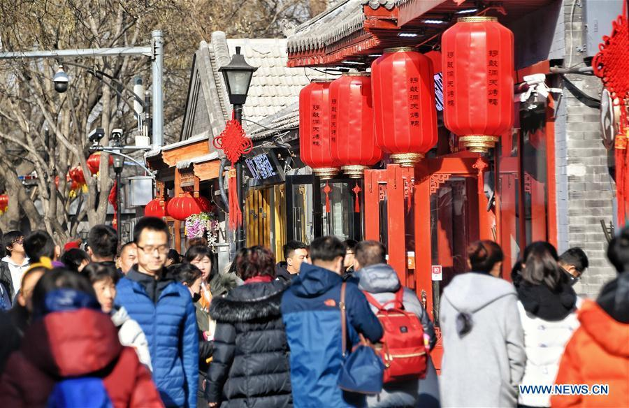 Tourists visit Nanluogu Alley in a festive atmosphere in Beijing, capital of China, Feb. 1, 2019. The city is decorated to greet the coming Chinese Lunar New Year, which falls on Feb. 5 this year. (Xinhua/Li Xin)
