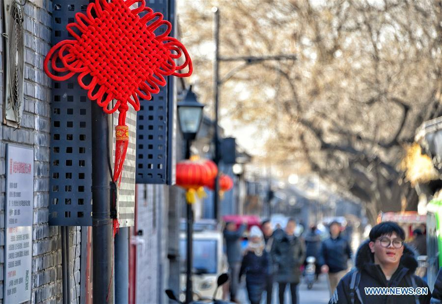 Chinese knot and lanterns are hung on a street to create a festive atmosphere at Maoer Hutong, a traditional alley, in Beijing, capital of China, Feb. 1, 2019. The city is decorated to greet the coming Chinese Lunar New Year, which falls on Feb. 5 this year. (Xinhua/Li Xin)
