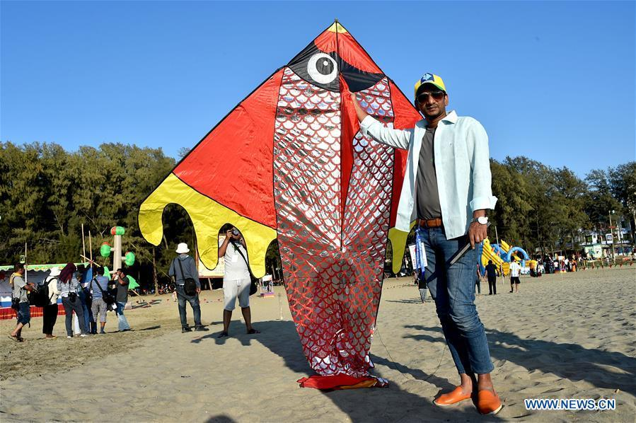 A man shows a kite during a two-day kite festival kicked off in Cox\'s Bazar in southeastern Bangladesh on Feb. 1, 2019. (Xinhua/Stringer)