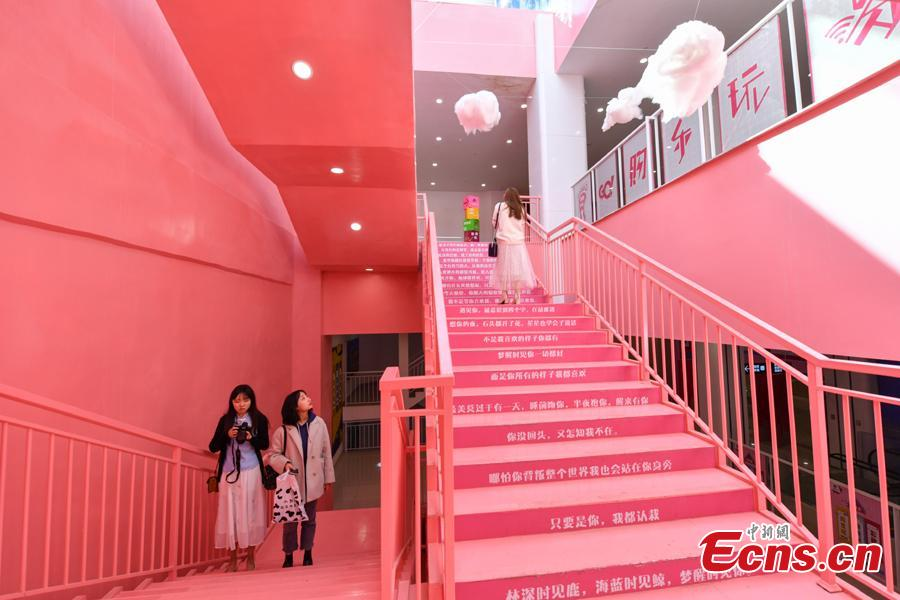 Passengers walk on pink stairs at the exit of Chunrong Street Subway Station in Kunming City, Southwest China's Yunnan Province. With cotton clouds suspended in the air and cute love quotes written on the stairs, the pink subway station has quickly gained widespread traction among young people. (Photo: China News Service/Ren Dong)