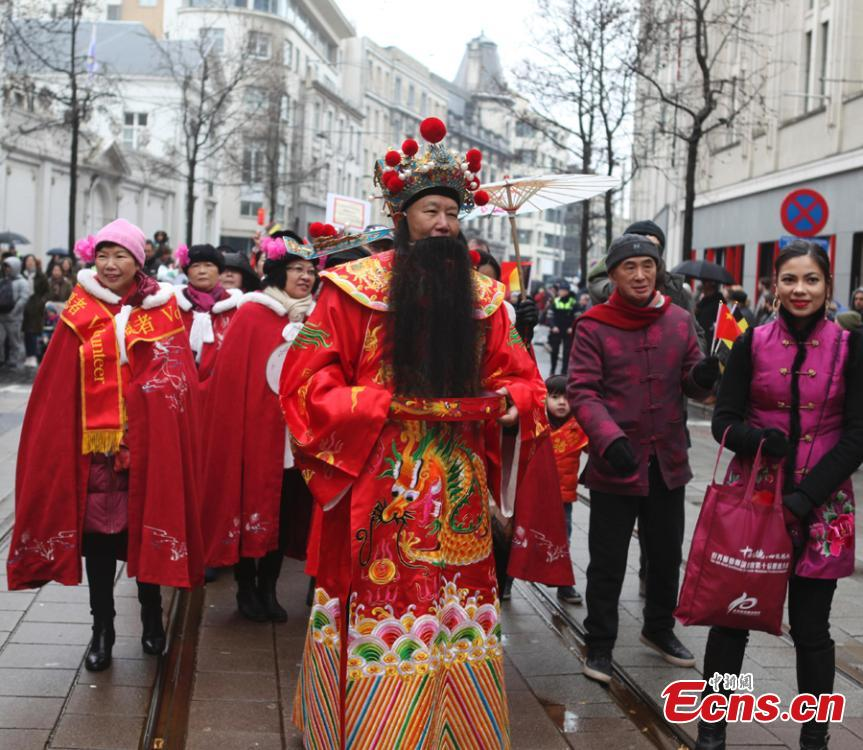People celebrate the Spring Festival, Chinese Lunar New Year, which falls on Feb. 5 this year, during a parade in Antwerp, the second largest city of Belgium after Brussels, Feb. 2, 2019. (Photo: China News Service/De Yongjian)