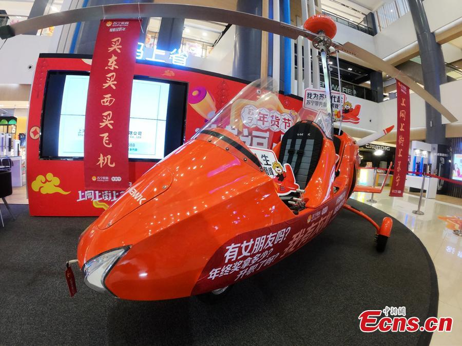 An autogyro, also known as a gyroplane, is on sale at a shopping mall in Shanghai, Feb. 2, 2019, ahead of the Spring Festival. The rotorcraft can fly at a maximum speed of 156 kilometers per hour and has a price tag of 691,800 yuan ($103,000). The mall is promoting it as the most expensive Lunar New Year gift. (Photo: China News Service/Zhang Hengwei)