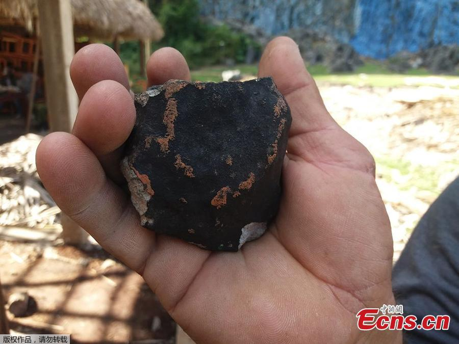 Handout picture released by Tele Pinar showing an alleged piece of a meteorite that fell in Cuba on February 1, 2019, taken in Vinalez, in the Cuban western province of Pinar del Rio. - The fall of a meteorite caused a strong explosion preceded by a flash that shook several municipalities in the Cuban province of Pinar del Rio, according to a member of the state astronomy institute.(Photo/Agencies)