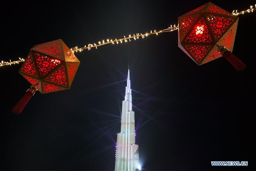 Light show is seen at Burj Khalifa, the world\'s tallest building, to celebrate the Chinese Lunar New Year in Downtown Dubai, the United Arab Emirates (UAE), Feb. 4, 2019. The Chinese Lunar New Year falls on Feb. 5 this year. (Xinhua/Mahmoud Khaled)