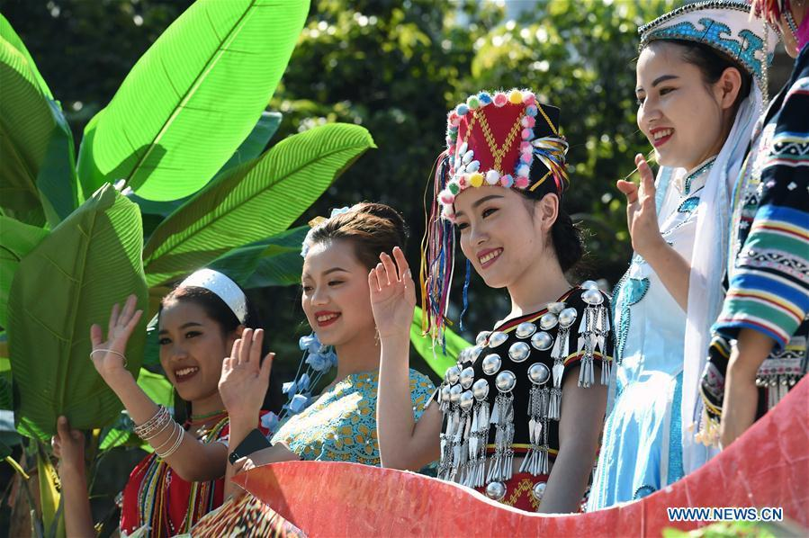 Women wave hands during a parade at Lancang Lahu Autonomous County in Pu\'er City, southwest China\'s Yunnan Province, Feb. 7, 2018. People of ethnic groups wearing their traditional festive costumes took part in a parade to celebrate the Chinese Lunar New Year in Lancang Lahu Autonomous County. (Xinhua/Yang Zongyou)