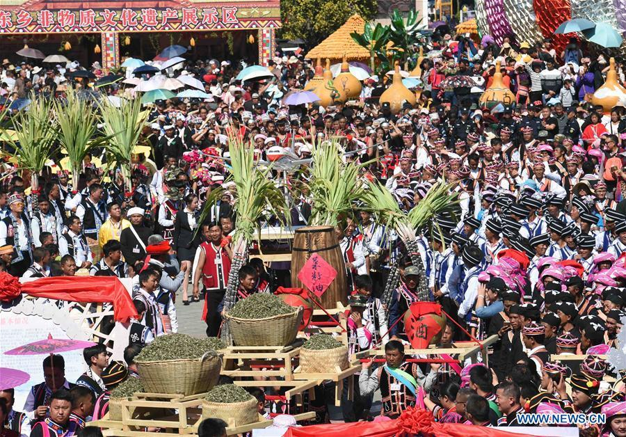 People attend Spring Festival celebration activities at a square in Lancang Lahu Autonomous County in Pu\'er City, southwest China\'s Yunnan Province, Feb. 7, 2018. People of ethnic groups wearing their traditional festive costumes took part in a parade to celebrate the Chinese Lunar New Year in Lancang Lahu Autonomous County. (Xinhua/Yang Zongyou)